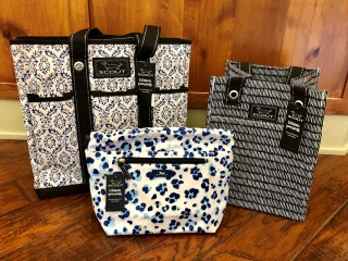 trio of needle work bags in different sizes and patterns
