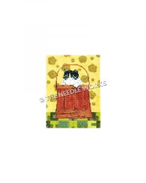 black and white cat peeking out of red bucket on yellow flowered background and green block patterned floor