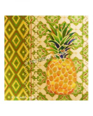 pineapple on green, gold and white elaborate plaid tablecloth