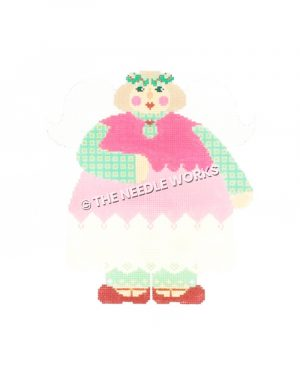 woman in pink dress with green plaid sleeves and white skirt wearing holly wreath on head