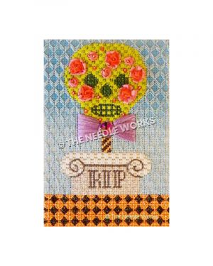 yellow skull face with pink flowers and purple bowtie above a grave with RIP on blue background and orange and black checkered floor