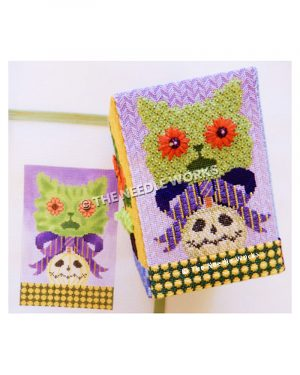 green cat face with red flower eyes with purple and yellow striped bow and white jackolantern on green floor with yellow polka dots