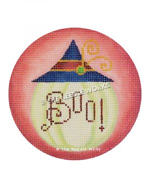 round pink ornament with white pumpkin with blue and red hat and BOO! written in red