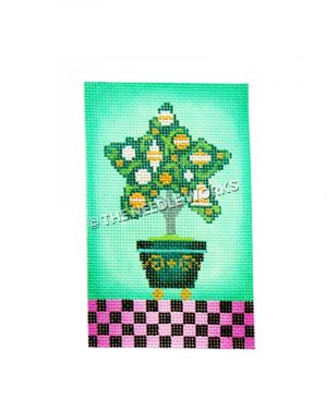 star shaped topiary with white and gold ornaments on green background with pink and black checkered floor
