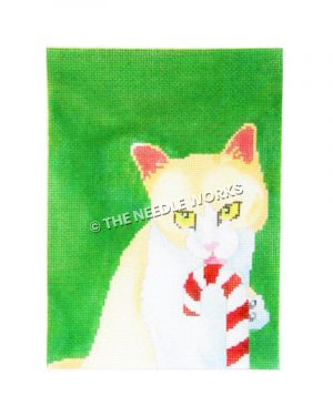 yellow and white cat licking candy cane on green background