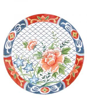 round plate with pink and blue flowers on blue and white fish scale background with red and blue alternating flowery border
