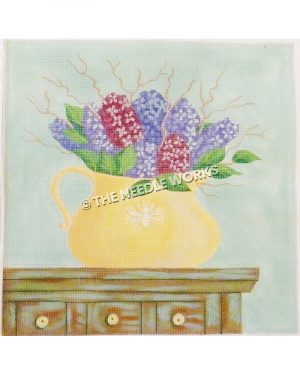 purple flowers in yellow vase on dresser with green background