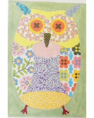 owl in pastel patchwork patterns in pink, purple, yellow, blue, and green with pink and yellow eyes on green background