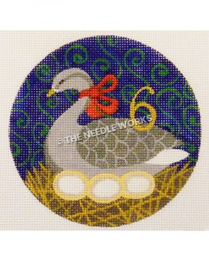 blue ornament with gray goose with three eggs in nest and gold 6 with green swirl background