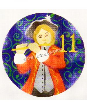 blue ornament with piper in red suit and black and white hat with gold 11 and green swirl background