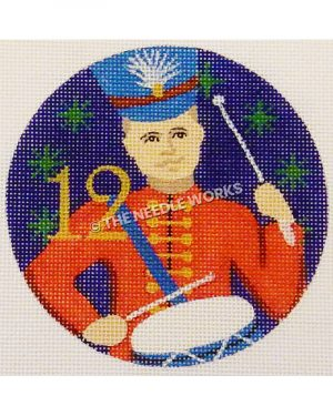 blue ornament with drummer boy in red suit and blue hat with gold 12 and green snowflakes