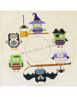 doughnut shape with green, black, purple owls in Halloween costumes