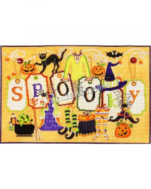 Spooky written on white tags hanging from white ribbon with Halloween decorations around including black cat, bat, jackolanterns, witch's hat and shoes, cauldron, spiders and webs and candy corn