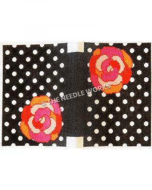 black clutch with white polka dots and red, orange, and pink flowers