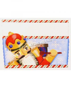 nutcracker in red and gold suit with white hair and beard with blue and red drum and white stripe on top and red, green and white candy stripe borders