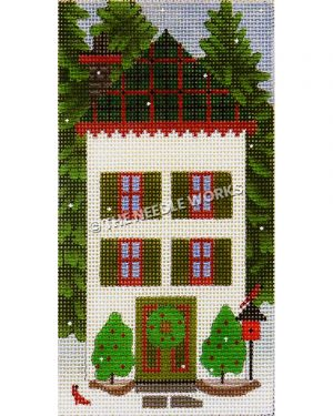 white two story house with green and red plaid roof and wreath on door with red birds on birdhouse and tall evergreens on each side