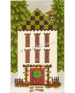 white two story house with green and black checkered roof and door framed by red and green trellis and wreath on door