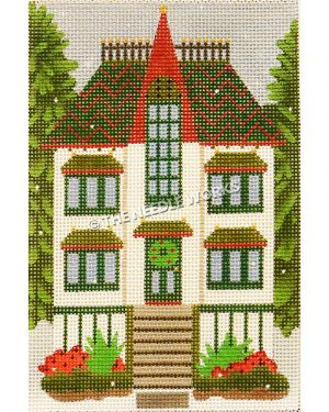 white two story house with red and green roof and wreath on door with tall evergreen trees on either side