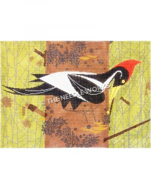 black and white woodpecker with red feathers on top sitting sideways on trunk with green and silver background