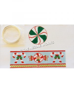 round box with green, red, and white peppermint top and blue band for sides with candy canes and red and white candy with face in center and green border