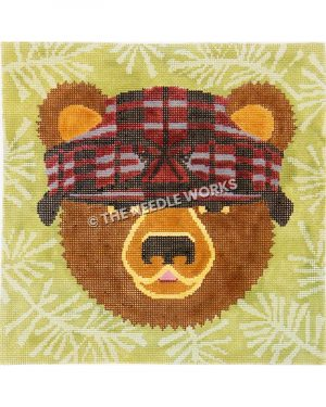 green ornament with brown bear wearing purple hat
