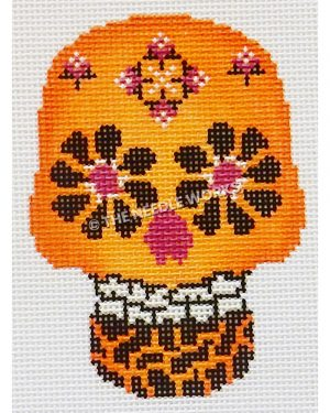 orange candy skull with black and pink eyes and pink and white decorative patterns on top of head and orange and black tiger pattern on bottom