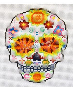 white candy skull with red and orange eyes with yellow trim and red, orange, blue, pink, and yellow flowers