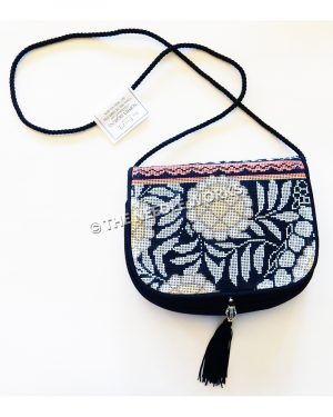 dark blue purse with snowflowers with pink patterned stripe