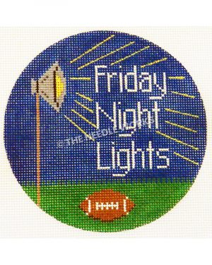 round ornament with Friday Night Lights next to stadium light on dark blue sky and football on ground below