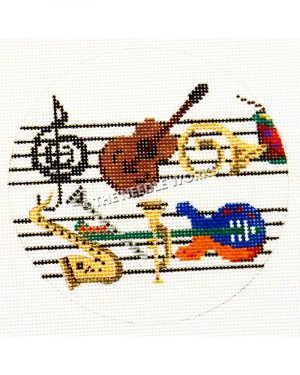 white round ornament with musical instruments on musical staff