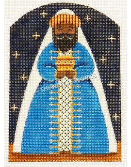 one of the three kings from nativity scene wearing blue and gold robe on dark blue starry sky