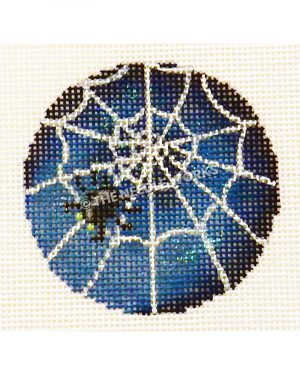 spider web ornament with blue and black background
