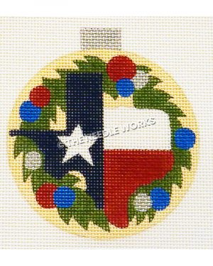 yellow ornament with shape of Texas with Texas flag colors and wreath with red, blue, and white ornament balls