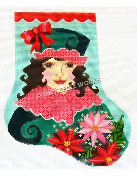teal stocking with red trim and brunette woman wearing green dress with red and white collar and green hat with red and white trim holding poinsettia plant