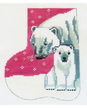 pink and white stocking with polar bear and cub sitting on snow