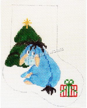 white stocking with Eeyore sitting in front of Christmas tree with red, white and green present