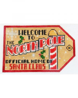 Welcome to the North Pole Offical Home of Santa Claus beige Christmas tag with red and white pole, snowflakes and holly leaves