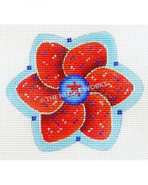 red flower with white and blue dots and red star in blue circle center