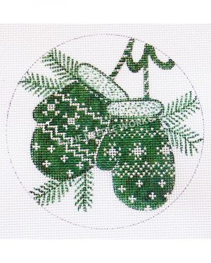 white ornament with green mittens and pine branches