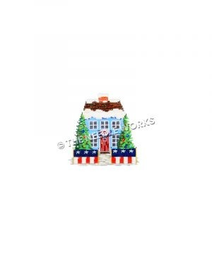 blue house snow-covered roof with patriotic decorations and Christmas trees in front