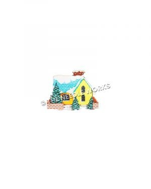 yellow house with blue snow-covered roof and Christmas trees in yard