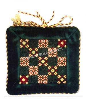 square gift ornament in red, green and gold patterns in checkered layout with gold and red bow