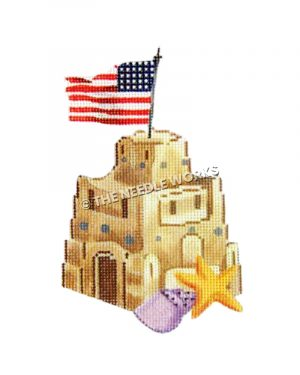 sand castle with American flag on top and purple seashell and starfish