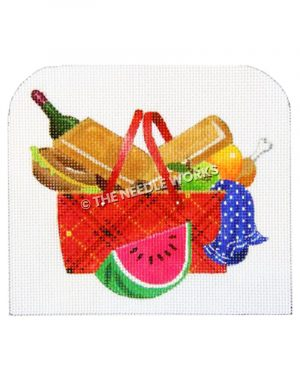 red, black and yellow plaid picnic basket overflowing with food, wine bottle, blue towel with white polka dots and slice of watermelon in front