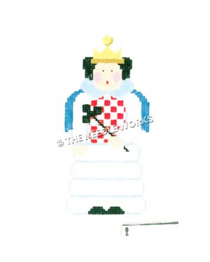 dark-haired queen with red and white checkered shirt and white skirt carrying three-leaf clover wand