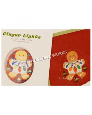 gingerbread ornament wearing white sweater with Christmas lights and trees surrounding