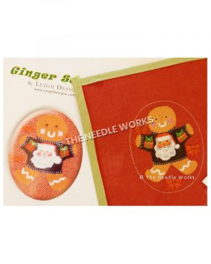 gingerbread ornament wearing black sweater with Santa's face and red presents on sleeves