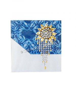 diamond and gold sunflower brooch on blue and white decorative background