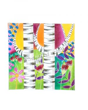 two birch trees with bright colored background and flowers