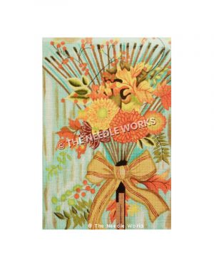 orange and gold flowers on rake with brown and red bow on blue background